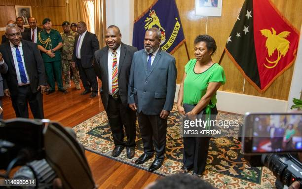 James Marape poses for photos after being sworn in as the new Prime Minister of Papua New Guinea by Governor General Bob Dadae in Port Moresby on May...
