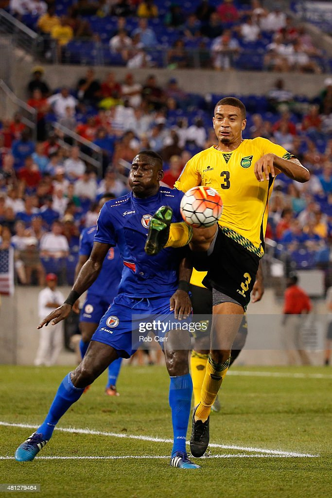 James Marcelin #14 of Haiti and goalie Michael Hector #3 of Jamaica go for the ball in the second half during the 2015 CONCACAF Gold Cup quarterfinal match at M&T Bank Stadium on July 18, 2015 in Baltimore, Maryland.