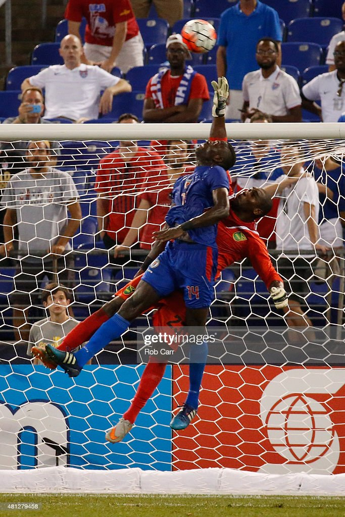 James Marcelin #14 of Haiti and goalie Ryan Thompson #23 of Jamaica go up for the ball in the second half during the 2015 CONCACAF Gold Cup quarterfinal match at M&T Bank Stadium on July 18, 2015 in Baltimore, Maryland.
