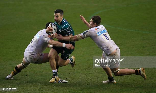 James Marshall of London Irish is tackled by Tim Cardell and Tom Willis of Wasps during the AngloWelsh Cup match between London Irish and Wasps at...