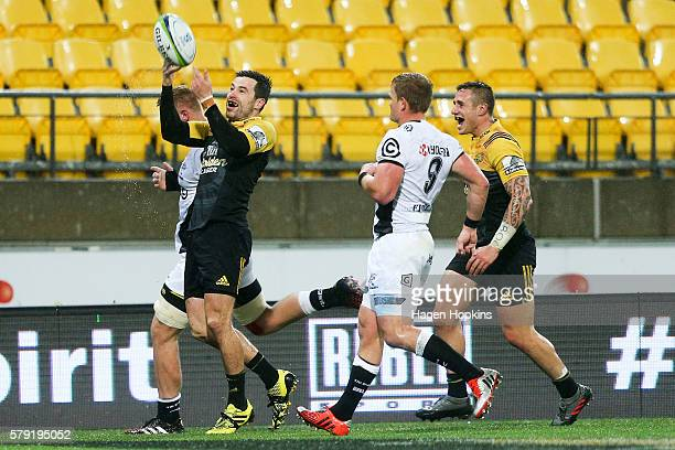 James Marshall of the Hurricanes celebrates after scoring a try during the Super Rugby Quarterfinal match between the Hurricanes and the Sharks at...