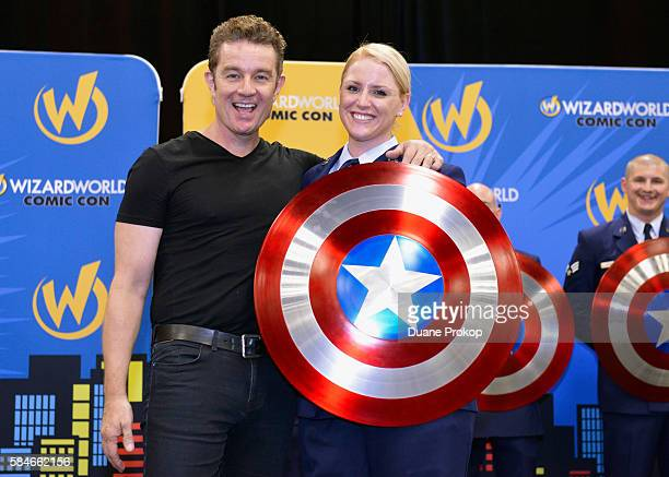 James Marsters and Staff Sergeant Shayna Perry pose for photos during the Wizard World Columbus Heroes Honoring Heroes event on July 29 2016 in...