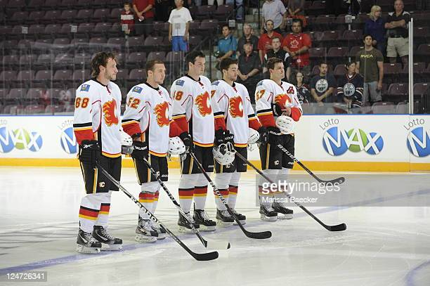 James Martin, Mitch Wahl, Greg Nemisz, Sven Baertschi and Lance Bouma of the Calgary Flames line up against the San Jose Sharks during game 1 of the...