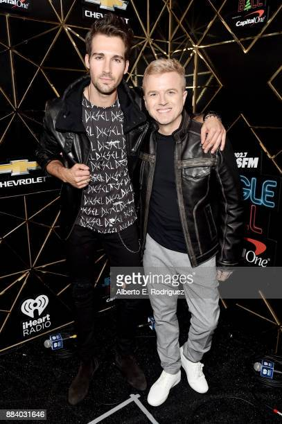 James Maslow and JoJo Wright pose in the press room during 1027 KIIS FM's Jingle Ball 2017 presented by Capital One at The Forum on December 1 2017...