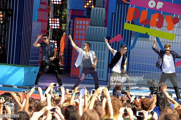 James Maslow Carlos Pena Jr Logan Henderson and Kendall Schmidt of the Big Time Rush take the stage at Nickelodeon's 10th Annual Worldwide Day of...