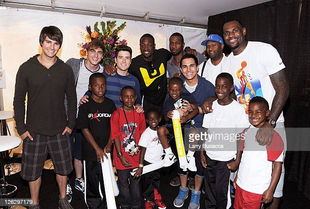 James Maslow Kendall Schmidt Logan Henderson and Carlos Pena of Big Time Rush pose with NBA Player LeBron James and Dwyane Wade as Nickelodeon...