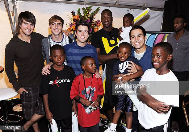 James Maslow Kendall Schmidt Logan Henderson and Carlos Pena of Big Time Rush pose with NBA Player Dwyane Wade as Nickelodeon celebrates the largest...