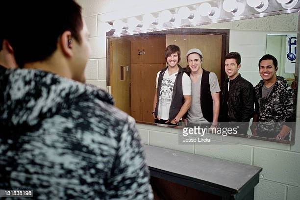 James Maslow Kendall Schmidt Logan Henderson and Carlos Pena of Big Time Rush are seen at Sycamore High School for their performance on October 29...