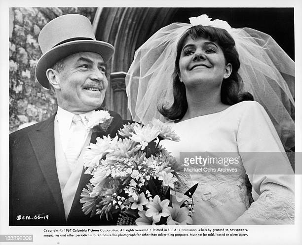 James Mason accompanying Lynn Redgrave at wedding in a scene from the film 'Georgy Girl' 1966
