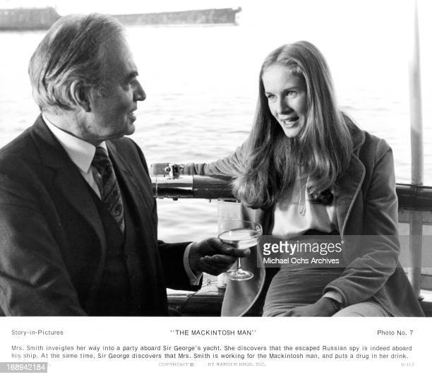James Mason and Dominique Sanda shoots a gun in a scene from the film 'The MacKintosh Man', 1973.