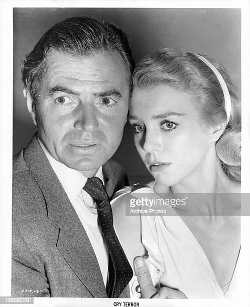 James Mason and Inger Stevens hold each other in a scene from the film 'Cry Terror' 1958