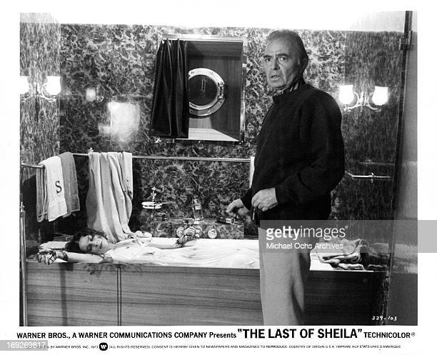 James Mason at site of dead woman in a scene from the film 'The Last Of Sheila', 1973.