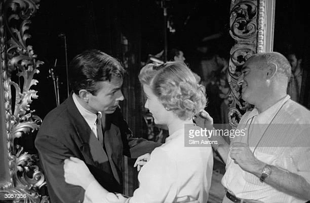 James Mason director Max Ophuls and Barbara Bel Geddes on the set of the film 'Caught' November 1948