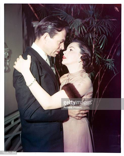 James Mason embracing Judy Garland in a scene from the film 'A Star Is Born', 1954.