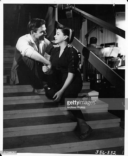 James Mason puts his arm around Judy Garland in a scene from the film 'A Star Is Born', 1954.