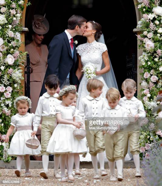 James Matthews and Pippa Middleton leave St Mark's Church along with their bridesmaids and pageboys including Prince George of Cambridge after their...