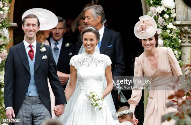 James Matthews and Pippa Middleton leave St Mark's Church along with Catherine Duchess of Cambridge after their wedding on May 20 2017 in Englefield...
