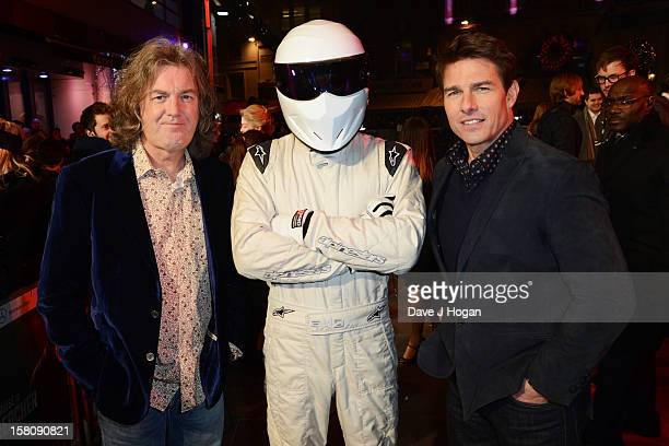 James May The Stig and Tom Cruise attend the world premiere of 'Jack Reacher' at The Odeon Leicester Square on December 10 2012 in London England