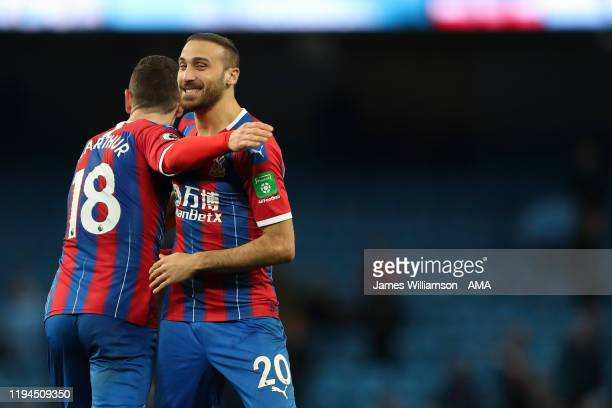James McArthur and Cenk Tosun of Crystal Palace at full time of the Premier League match between Manchester City and Crystal Palace at Etihad Stadium...
