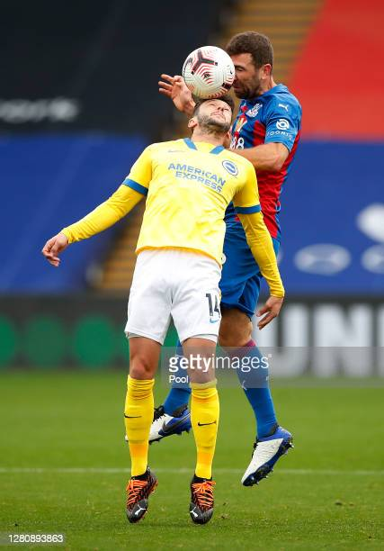 James McArthur of Crystal Palace and Adam Lallana of Brighton and Hove Albion battle for the ball during the Premier League match between Crystal...