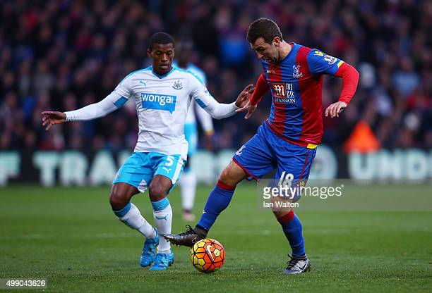 James McArthur of Crystal Palace and Georginio Wijnaldum of Newcastle United compete for the ball during the Barclays Premier League match between...