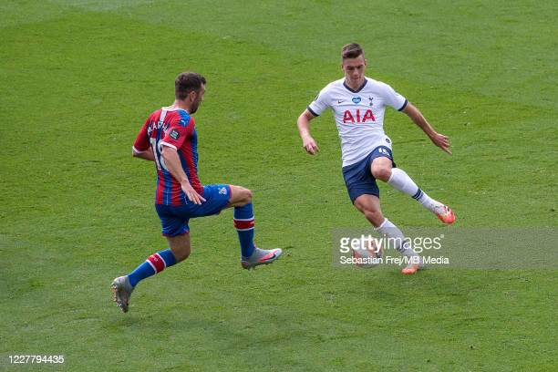 James McArthur of Crystal Palace and Giovani Lo Celso of Tottenham Hotspur in action during the Premier League match between Crystal Palace and...