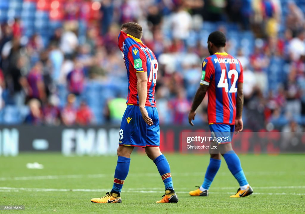 James McArthur of Crystal Palace and Jason Puncheon of Crystal Palace walk off dejected after the Premier League match between Crystal Palace and Swansea City at Selhurst Park on August 26, 2017 in London, England.