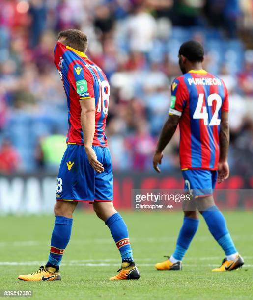 James McArthur of Crystal Palace and Jason Puncheon of Crystal Palace walk off dejected after the Premier League match between Crystal Palace and...