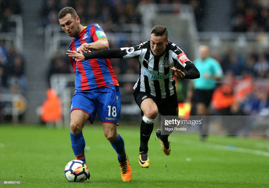 James McArthur of Crystal Palace and Javi Manquillo of Newcastle United during the Premier League match between Newcastle United and Crystal Palace at St. James Park on October 21, 2017 in Newcastle upon Tyne, England.