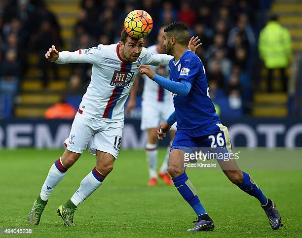 James McArthur of Crystal Palace and Riyad Mahrez of Leicester City compete for the ball during the Barclays Premier League match between Leicester...