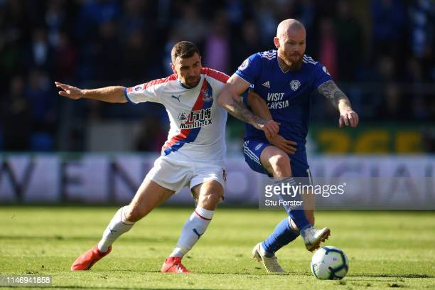 James McArthur of Crystal Palace battles for possession with Aron Gunnarsson of Cardiff City during the Premier League match between Cardiff City and...