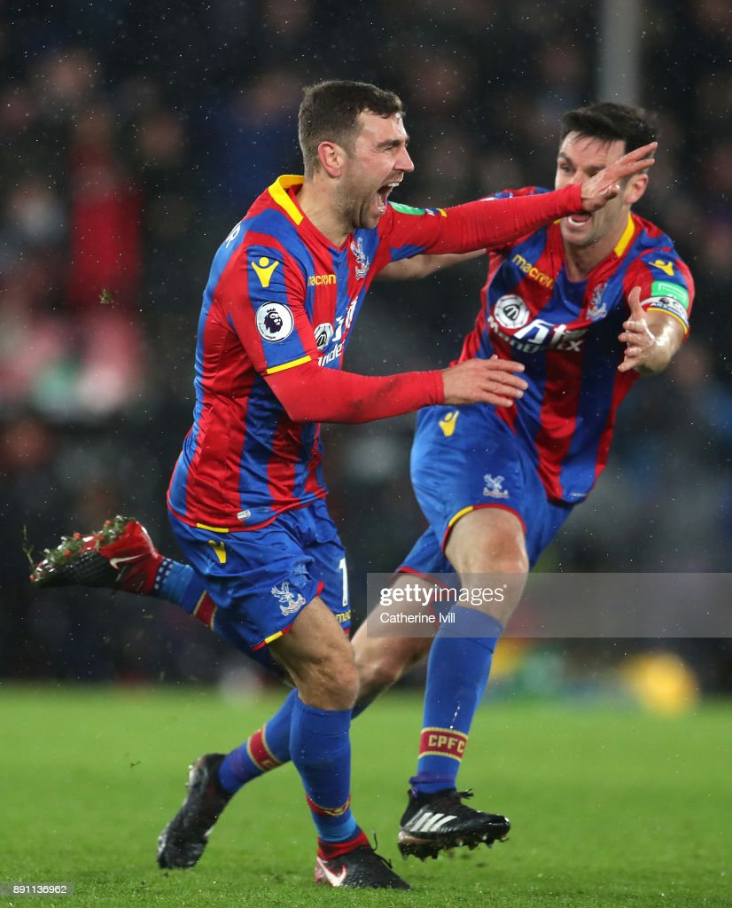 James McArthur of Crystal Palace celebrates after scoring his sides second goal with teammate Scott Dann during the Premier League match between Crystal Palace and Watford at Selhurst Park on December 12, 2017 in London, England.