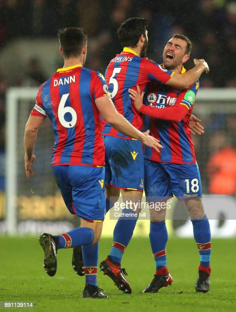 James McArthur of Crystal Palace celebrates after scoring his sides second goal with James Tomkins and Scott Dann during the Premier League match...