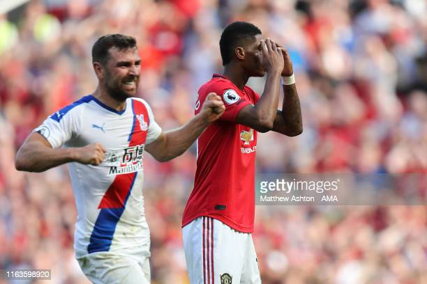 James McArthur of Crystal Palace celebrates as Marcus Rashford of Manchester United misses a second half penalty during the Premier League match...