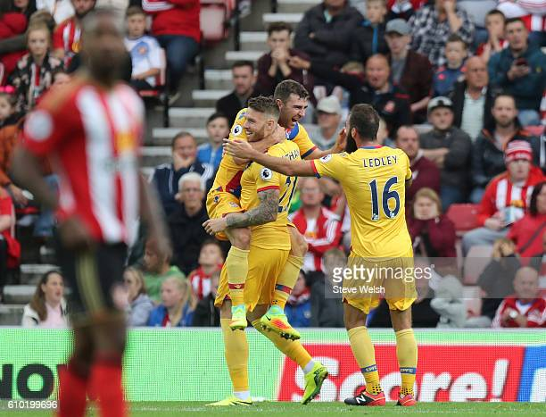 James McArthur of Crystal Palace celebrates his goal with Captain Lee Cattermole and Joe Ledley during the Premier League match between Sunderland...