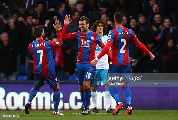 James McArthur of Crystal Palace celebrates scoring his team's first goal with his team mates Yohan Cabaye and Joel Ward during the Barclays Premier...