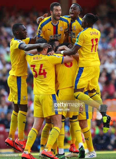 James McArthur of Crystal Palace celebrates with teammates after scoring his team's third goal during the Premier League match between Arsenal FC and...