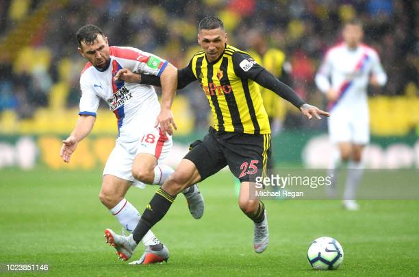 James McArthur of Crystal Palace challenges for the ball with Jose Holebas of Watford during the Premier League match between Watford FC and Crystal...