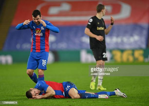 James McArthur of Crystal Palace checks on Gary Cahill of Crystal Palace who goes down injured holding his head during the Premier League match...