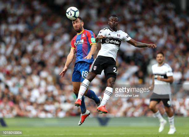 James McArthur of Crystal Palace comptes for a header with Jean Michael Seri of Fulham during the Premier League match between Fulham FC and Crystal...