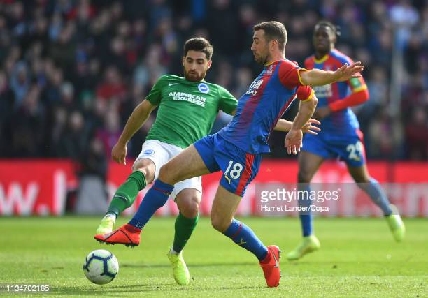 James McArthur of Crystal Palace is challenged by Alireza Jahanbakhsh of Brighton Hove Albion during the Premier League match between Crystal Palace...