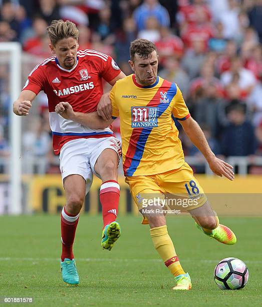 James McArthur of Crystal Palace is tackled by Gaston Ramirez of Middlesbrough during the Premier League match between Middlesbrough FC and Crystal...