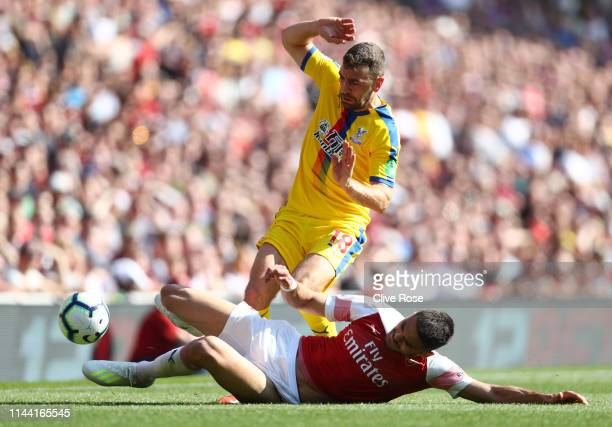 James McArthur of Crystal Palace is tackled by Konstantinos Mavropanos of Arsenal during the Premier League match between Arsenal FC and Crystal...