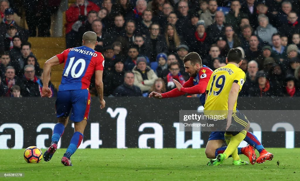 James McArthur of Crystal Palace (C) is tackled by Stewart Downing of Middlesbrough (R) during the Premier League match between Crystal Palace and Middlesbrough at Selhurst Park on February 25, 2017 in London, England.