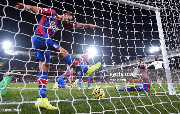 James McArthur of Crystal Palace reacts after Liverpool's second goal scored by Roberto Firmino during the Premier League match between Crystal...