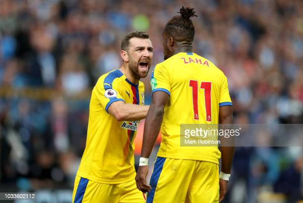James McArthur of Crystal Palace reacts towards Wilfried Zaha of Crystal Palace during the Premier League match between Huddersfield Town and Crystal...