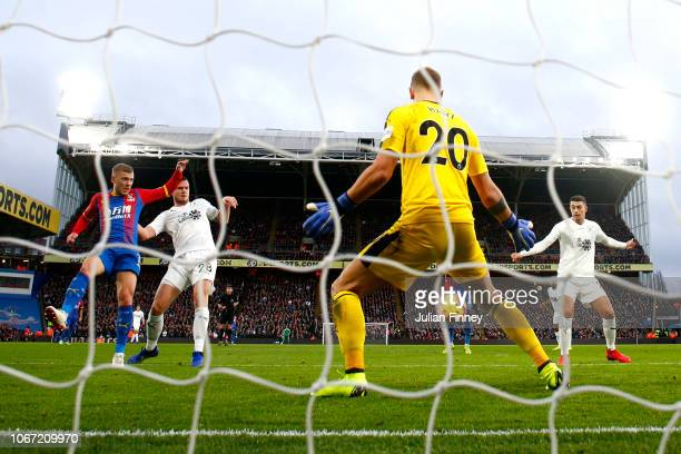James McArthur of Crystal Palace scores his team's first goal during the Premier League match between Crystal Palace and Burnley FC at Selhurst Park...