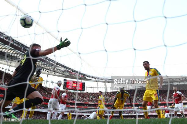 James McArthur of Crystal Palace scores his team's third goal past Bernd Leno of Arsenal during the Premier League match between Arsenal FC and...
