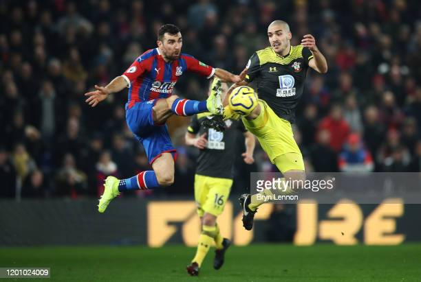 James McArthur of Crystal Palace tackles in the air with Oriol Romeu of Southampton during the Premier League match between Crystal Palace and...