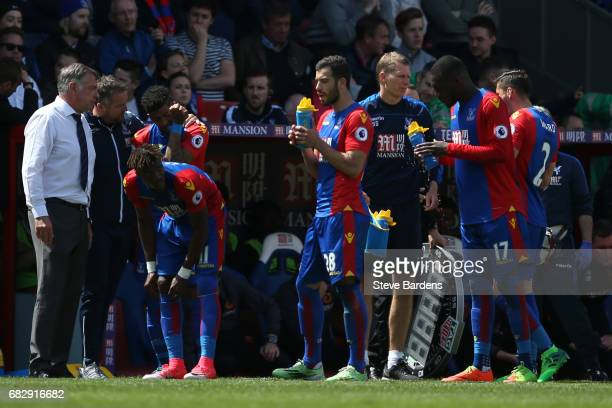 James McArthur of Crystal Palace takes on some water as Sam Allardyce Manager of Crystal Palace speaks to his team during the Premier League match...
